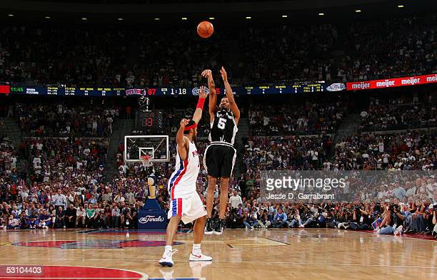 Robert Horry of the San Antonio Spurs shoots and makes a 3point shot with 118 left on the clock to put the Spurs up 8887 against Rasheed Wallace of...