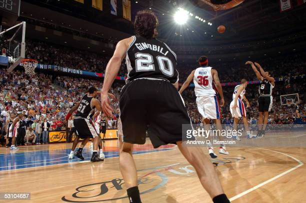 Robert Horry of the San Antonio Spurs shoots the game-winning three-point shot against Tayshaun Prince of the Detroit Pistons in Game five of the...