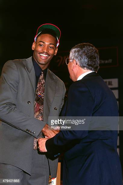 Robert Horry shakes hands with NBA Commissioner David Stern after he was selected number eleven overall by Houston Rockets during the 1992 NBA Draft...