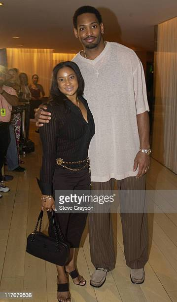 Robert Horry wife pose for photographers at the Los Angeles Lakers victory celebration at Ian Schrager's Ultra Chic Mondrian Hotel