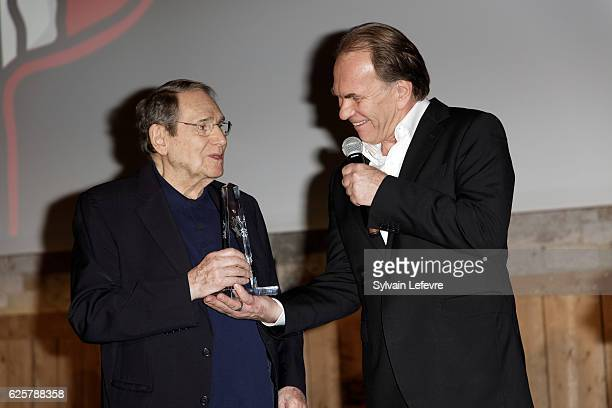Robert Hossein and Aleksei Guskov meet fans before the tribute to Robert Hossein during Russian Film Festival on November 25 2016 in Honfleur France