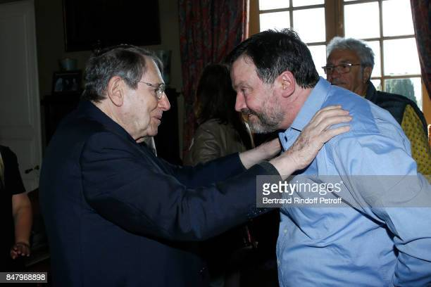 Robert Hossein and Bruno Finck attend the Garden Party organized by Bruno Finck companion of JeanClaude Brialy at Chateau De Monthyon on September 16...