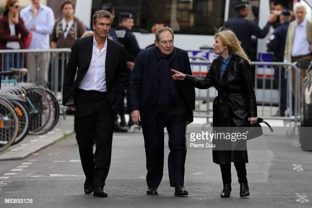 Robert Hossein and Candice Patou arrive at Jean Rochefort's Funeral At Eglise SaintThomas D'Aquin on October 13 2017 in Paris France