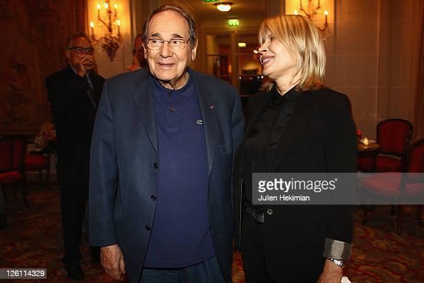 Robert Hossein and his wife Candice Patou attend the Andrei Konchalovsky Chevalier de la Legion d'Honneur ceremony at Hotel Bristol on September 22,...