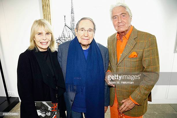 Robert Hossein his wife Candice Patou and Pierre Cornette de Saint Cyr attend the launch of PhotoManagement at galerie Opera on November 10 2015 in...