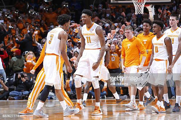 Robert Hubbs III and Kyle Alexander of the Tennessee Volunteers celebrate in the first half of the game against the Kentucky Wildcats at...