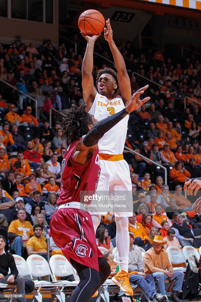 Robert Hubbs III #3 of the of the Tennessee Volunteers shoots against Chris Silva #30 of the South Carolina Gamecocks in a game at Thompson-Boling Arena on January 23, 2016 in Knoxville, Tennessee.