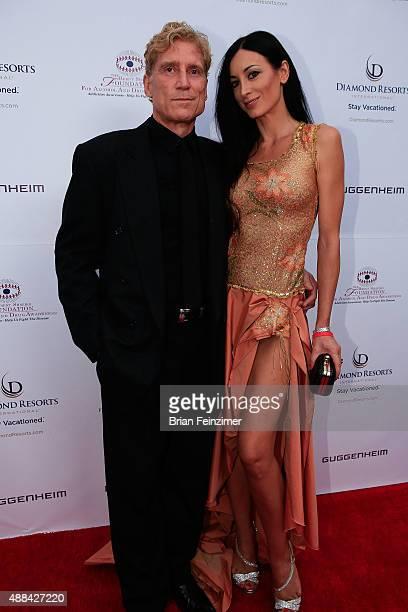 Robert Huizenga and Regina Salpagarova at The Brent Shapiro Foundation's Summer Spectacular on September 12 2015 in Beverly Hills California