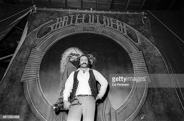 Robert Hunter poses in front of a Blues For Allah backdrop at the Grateful Dead's rehearsal studio Club Front in November 1977 in San Rafael...