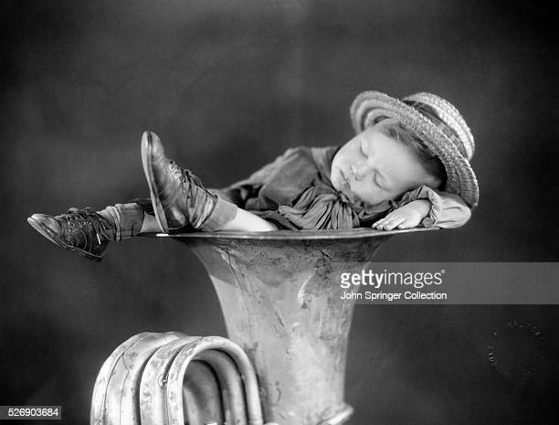 Robert Hutchins Wheezer in the Our Gang comedies naps in a tuba