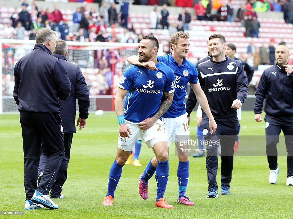 Robert Huth and Marcin Wasilewski of Leicester City celebrate their premier league survival after the Premier league match between Sunderland and Leicester City at The Stadium of Light on May 16, 2015 in Sunderland, England.
