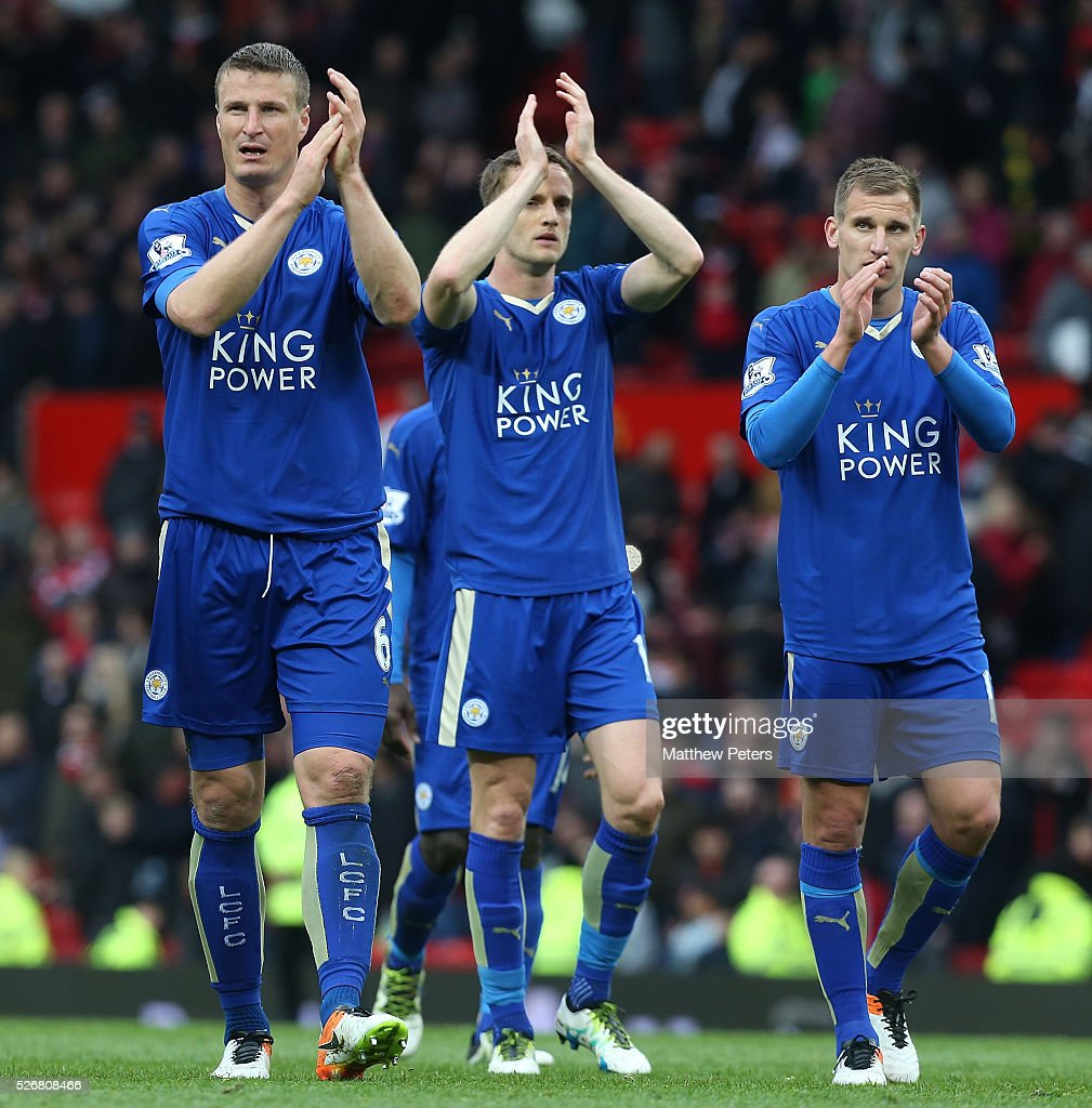 Robert Huth, Andy King and Marc Albrighton of Leicester City applaud the away fans after the Barclays Premier League match between Manchester United and Leicester City at Old Trafford on May 1, 2016 in Manchester, England.