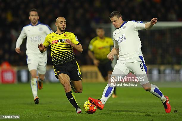 Robert Huth of Leicester City abd Nordin Amrabat of Watford compete for the ball during the Barclays Premier League match between Watford and...