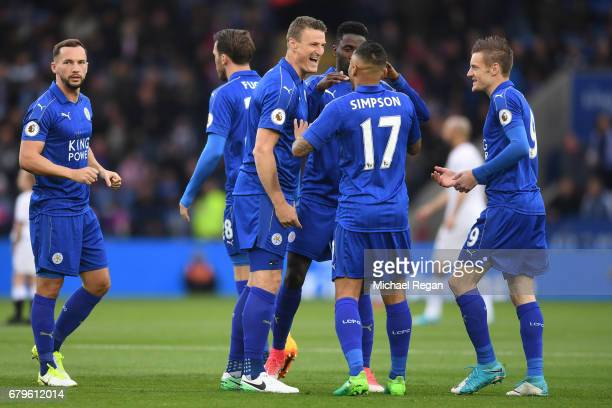 Robert Huth of Leicester City and Danny Simpson of Leicester City speak prior to the Premier League match between Leicester City and Watford at The...