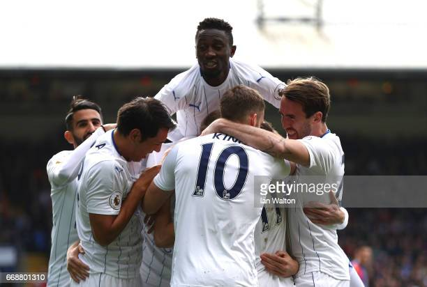 Robert Huth of Leicester City celebrates scoring his sides first goal with his Leicester City team mates during the Premier League match between...