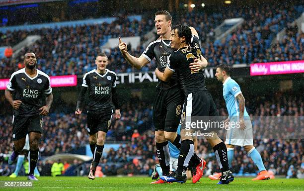 Robert Huth of Leicester City celebrates scoring his team's first goal with his team mate Shinji Okazaki during the Barclays Premier League match...