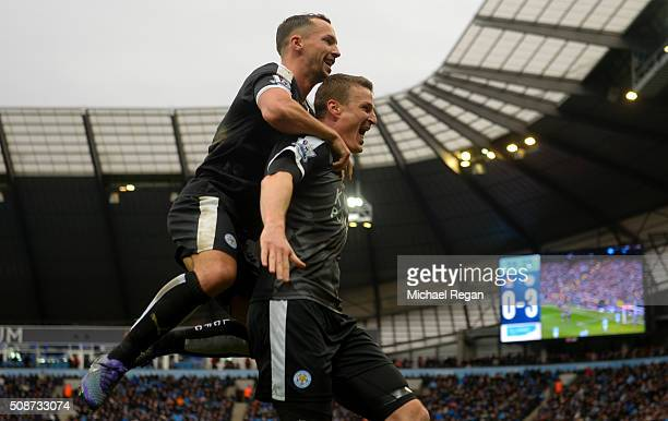 Robert Huth of Leicester City celebrates scoring his team's third goal with his team mate Danny Drinkwater during the Barclays Premier League match...
