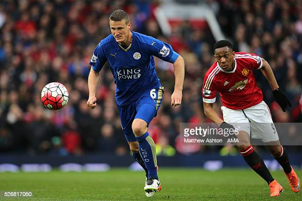Robert Huth of Leicester City competes with Anthony Martial of Manchester United during the Barclays Premier League match between Manchester United...