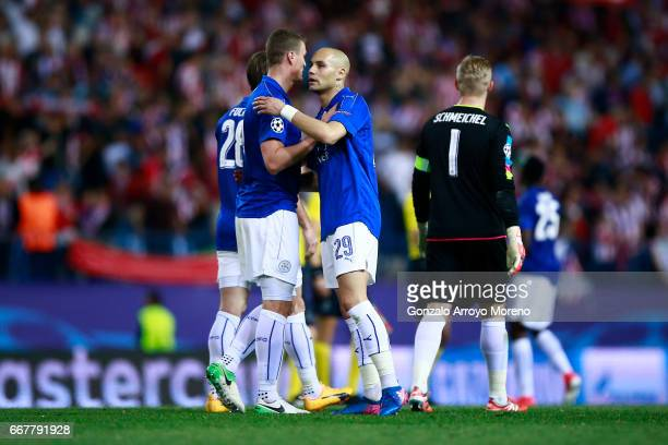 Robert Huth of Leicester City FC clashes hands with his teammate Yohan Benalouane after the UEFA Champions League Quarter Final first leg match...