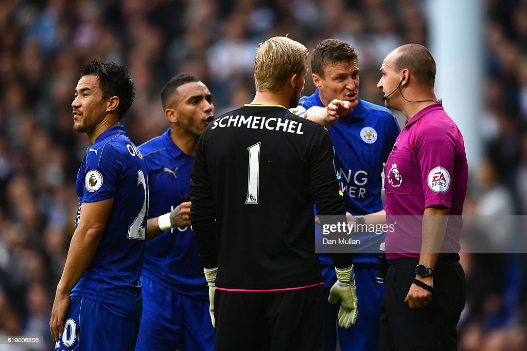 Robert Huth (2nd R) of Leicester City protests to referee Robert Madley (1st R) against his penalty dicision during the Premier League match between Tottenham Hotspur and Leicester City at White Hart Lane on October 29, 2016 in London, England.