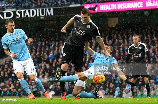 Robert Huth of Leicester City scores his team's first goal during the Barclays Premier League match between Manchester City and Leicester City at the...