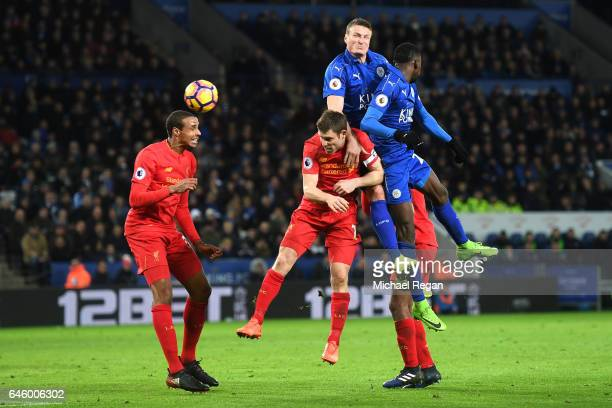 Robert Huth of Leicester City towers over James Milner of Liverpool to win a header during the Premier League match between Leicester City and...