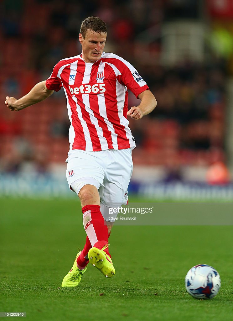 Robert Huth of Stoke City in action during the Capital One Cup Second Round match between Stoke City and Portsmouth at Britannia Stadium on August 27, 2014 in Stoke on Trent, England.