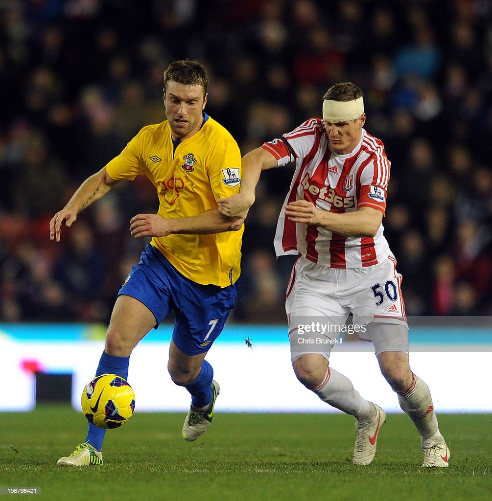 Robert Huth of Stoke City in action with Rickie Lambert of Southampton during the Barclays Premier League match between Stoke City and Southampton at Britannia Stadium on December 29, 2012 in Stoke on Trent, England.