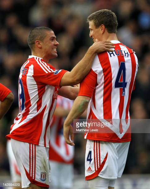 Robert Huth of Stoke City is congratulated by team mate Jonathan Walters after scoring his team's first goal during the Barclays Premier League match...