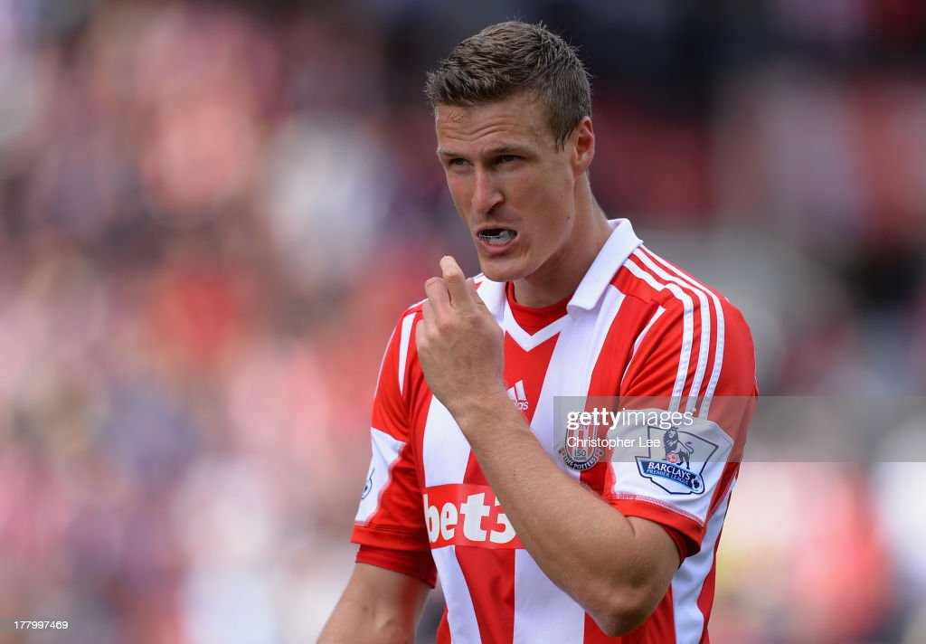 Robert Huth of Stoke City removes his mouthguard during the Barclays Premier League match between Stoke City and Crystal Palace at Britannia Stadium on August 24, 2013 in Stoke on Trent, England.