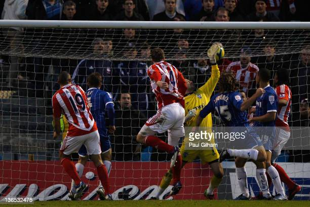 Robert Huth of Stoke City scores his teams third goal during the FA Cup Third Round match between Gillingham and Stoke City at Priestfield Stadium on...
