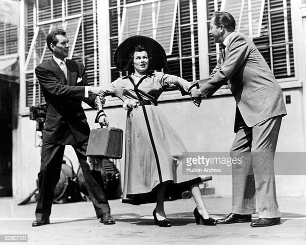 Robert Hutton and Robert Young fight over Barbara Hale in a scene from the film 'And Baby Makes Three' directed by Henry Levin for Columbia
