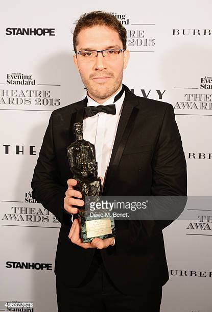 Robert Icke winner of Best Director for 'Oresteia' poses in front of the Winners Boards at The London Evening Standard Theatre Awards in partnership...