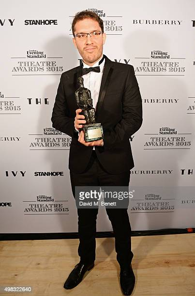 Robert Icke winner of Best Director for Oresteia poses in front of the Winners Boards at The London Evening Standard Theatre Awards in partnership...