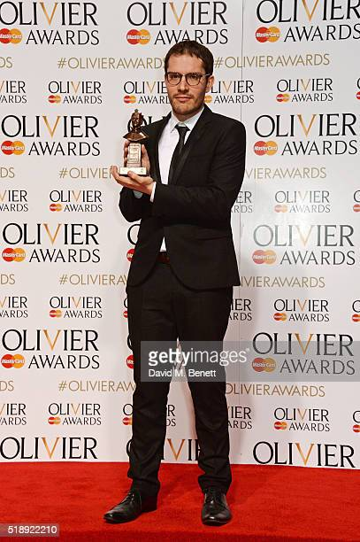 Robert Icke winner of the Best Director award for Oresteia poses in the Winners Room at The Olivier Awards with Mastercard at The Royal Opera House...