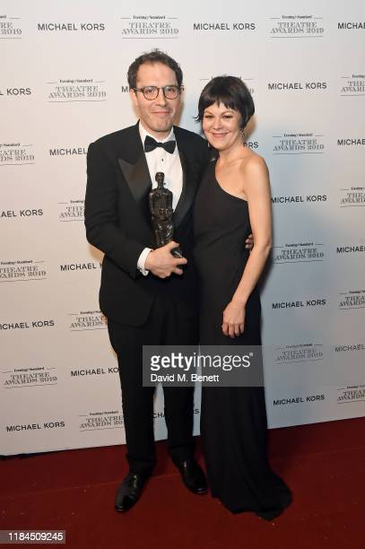 Robert Icke winner of the Milton Shulman Award for Best Director for 'The Doctor' and Helen McCrory pose in the winners room at the 65th Evening...