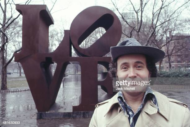 Robert Indiana with his 'LOVE' sculpture in Central Park New York City in 1971