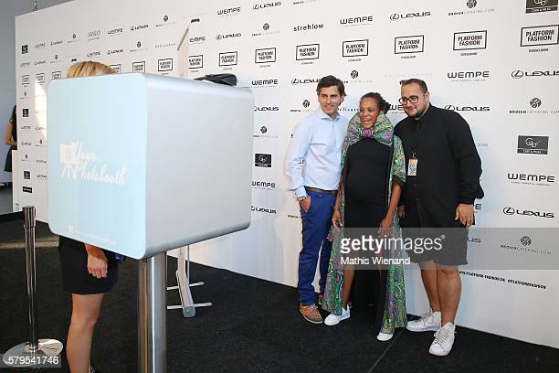 Robert Irschara Milka Loff Fernandes and a guest pose infront of a photobooth ahead of the Platform Fashion Selected show during Platform Fashion...