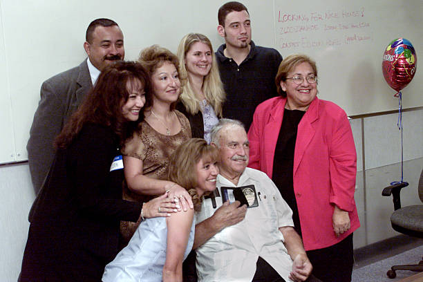 Robert J Hinostro Poses With Family Members For A Photo After He Was Presented