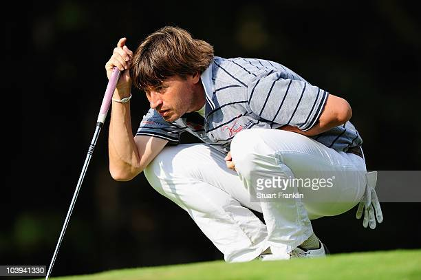 Robert Jan Derksen of The Netherlands lines up his putt on the 14th hole during the first round of The KLM Open Golf at The Hillversumsche Golf Club...