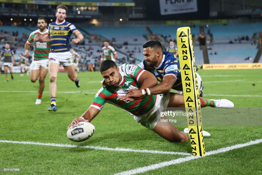 Robert Jennings of the Rabbitohs beats Bevan French of the Eels to score in the corner during the round 15 NRL match between the Parramatta Eels and the South Sydney Rabbitohs at ANZ Stadium on June 14, 2018 in Sydney, Australia.