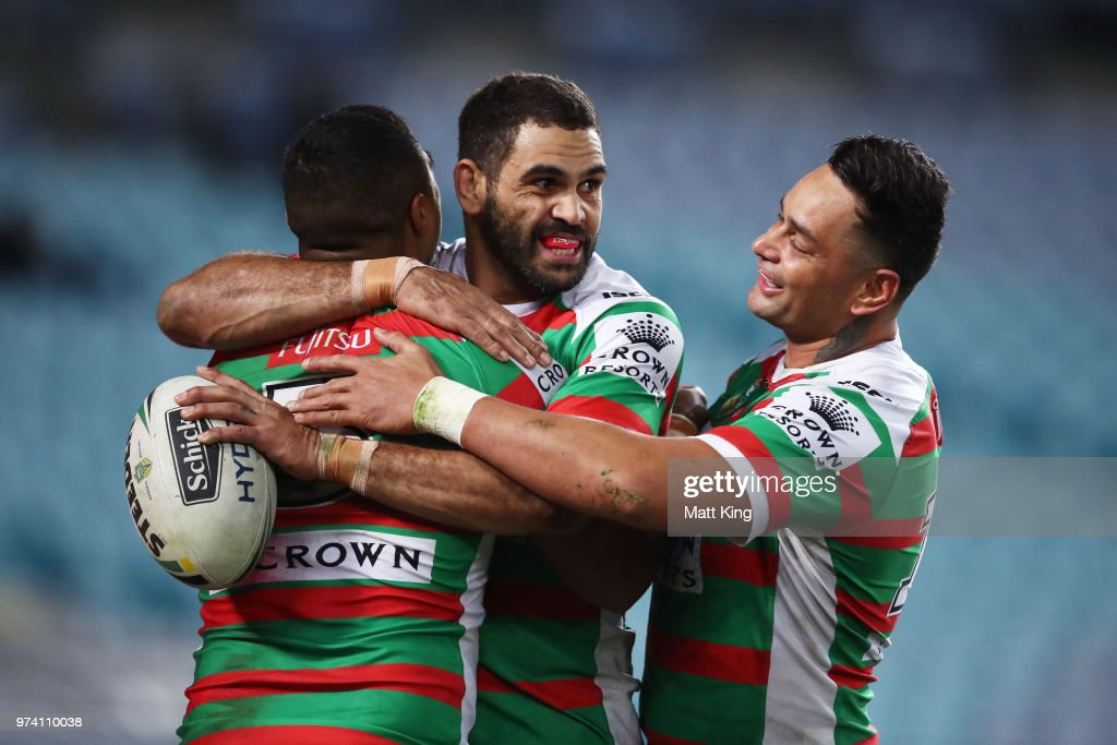 Robert Jennings of the Rabbitohs (L) celebrates with Greg Inglis (C) and John Sutton (R) after scoring a try during the round 15 NRL match between the Parramatta Eels and the South Sydney Rabbitohs at ANZ Stadium on June 14, 2018 in Sydney, Australia.
