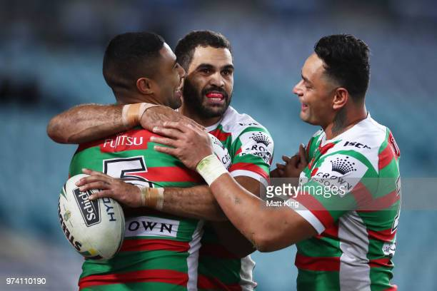 Robert Jennings of the Rabbitohs celebrates with Greg Inglis and John Sutton after scoring a try during the round 15 NRL match between the Parramatta...