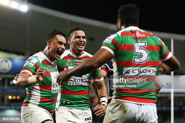 Robert Jennings of the Rabbitohs celebrates with team mate John Sutton after scoring a try during the round six NRL match between the Sydney Roosters...