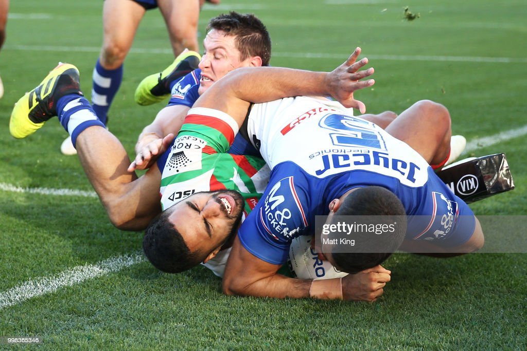 Robert Jennings of the Rabbitohs is tackled in to touch by Reimis Smith of the Bulldogs during the round 18 NRL match between the Canterbury Bulldogs and the South Sydney Rabbitohs at ANZ Stadium on July 14, 2018 in Sydney, Australia.