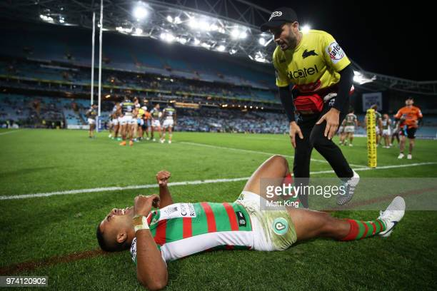 Robert Jennings of the Rabbitohs lies doen injured after scoring a try in the corner during the round 15 NRL match between the Parramatta Eels and...