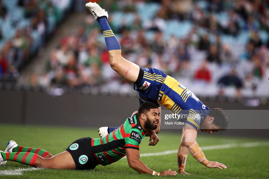 Robert Jennings of the Rabbitohs plays the ball under pressure from Tepai Moeroa of the Eels during the round 20 NRL match between the South Sydney Rabbitohs and the Parramatta Eels at ANZ Stadium on July 28, 2018 in Sydney, Australia.