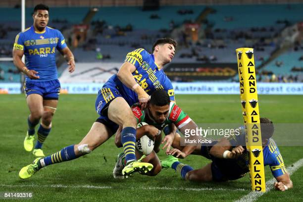 Robert Jennings of the Rabbitohs scores a try during the round 26 NRL match between the Parramatta Eels and the South Sydney Rabbitohs at ANZ Stadium...