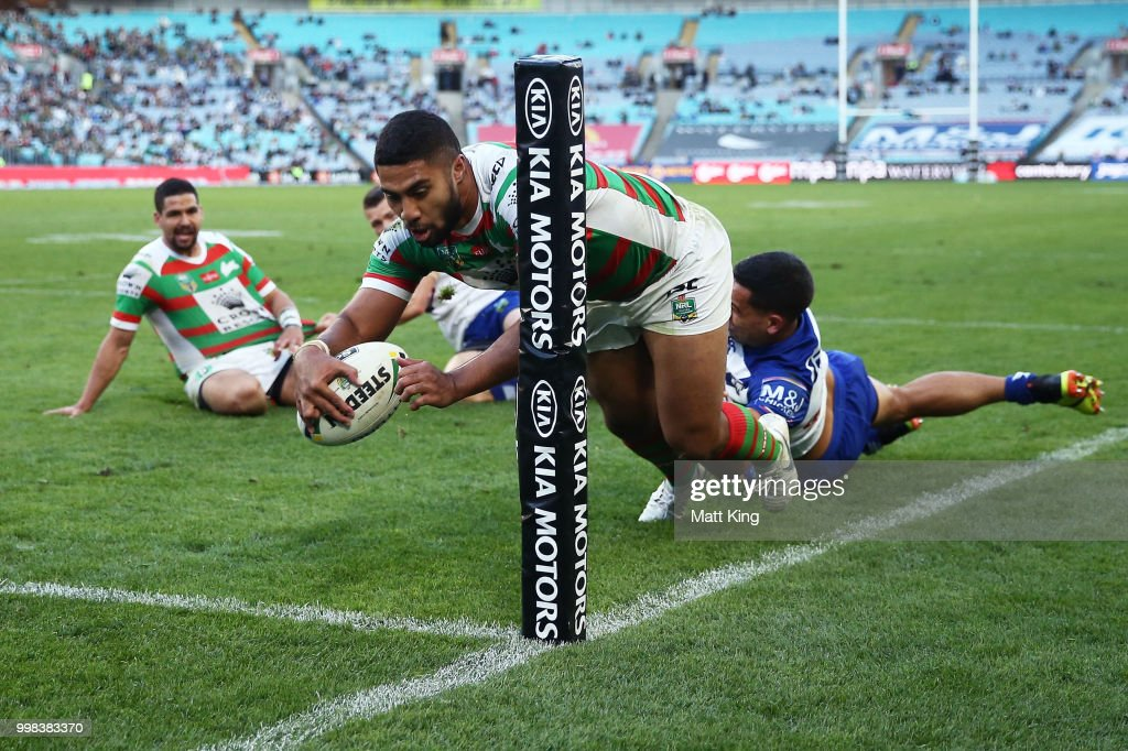Robert Jennings of the Rabbitohs scores in the corner during the round 18 NRL match between the Canterbury Bulldogs and the South Sydney Rabbitohs at ANZ Stadium on July 14, 2018 in Sydney, Australia.
