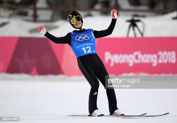 Robert Johansson of Norway celebrates as he lands his final jump winning Noway the gold medal in the Ski Jumping Men's Team Large Hill on day 10 of...